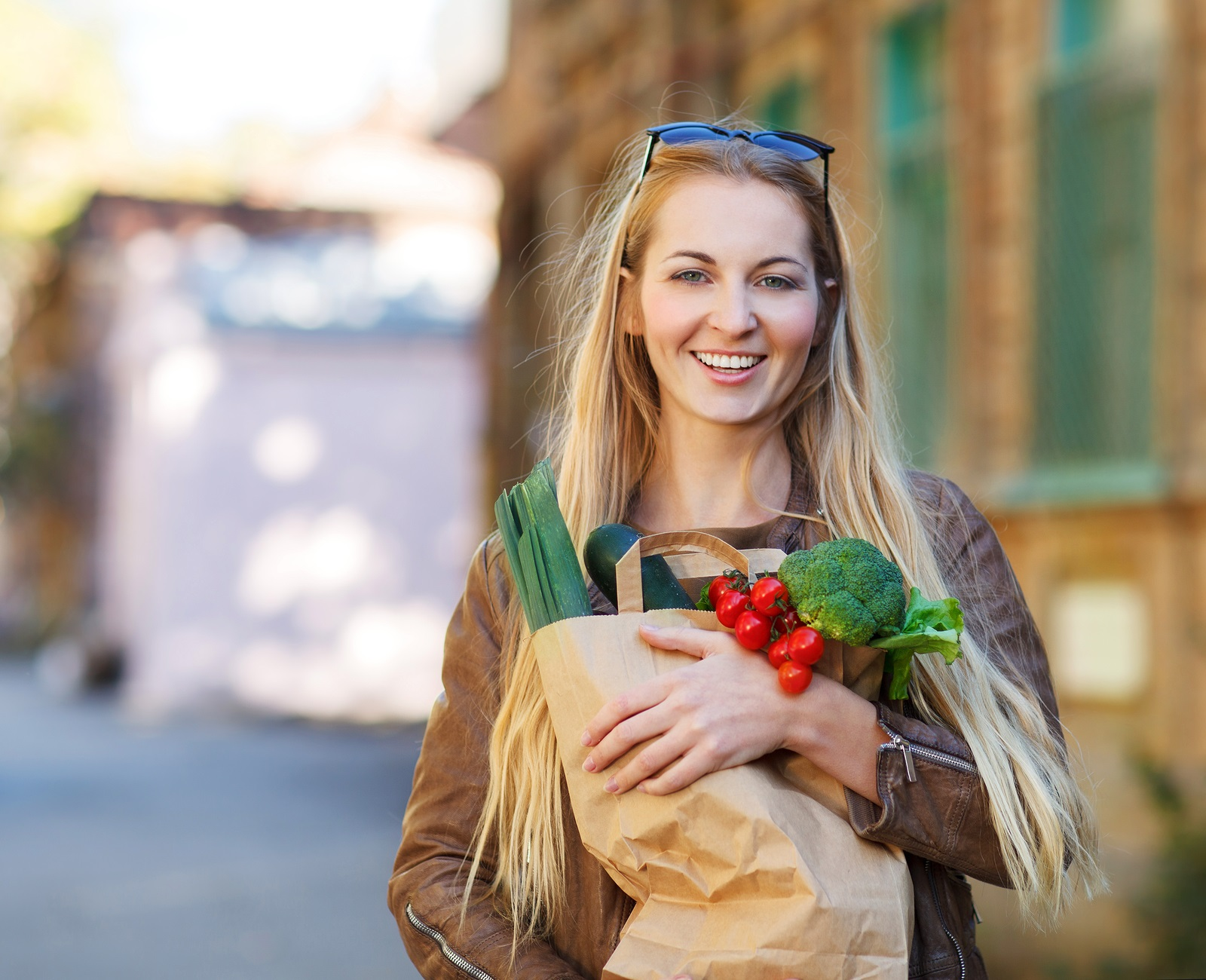 Young happy woman with shopping bags outdoors